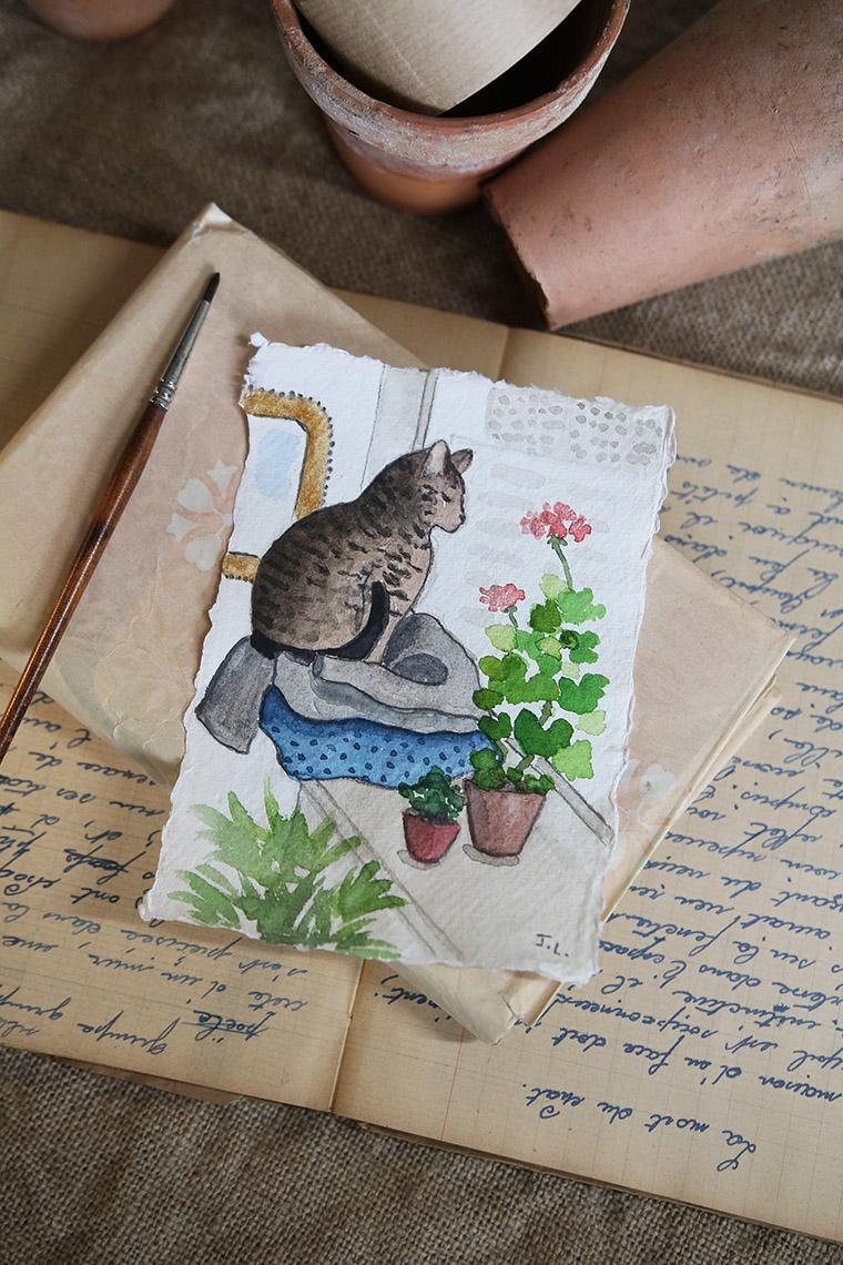 Chat à l'aquarelle avec des géraniums