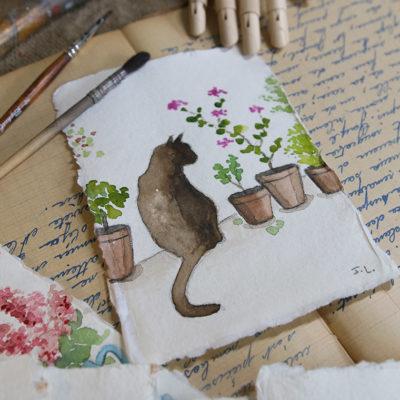 Des boîtes d'aquarelle et des chats