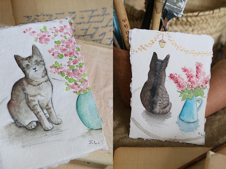 Chats à l'aquarelle avec des fleurs